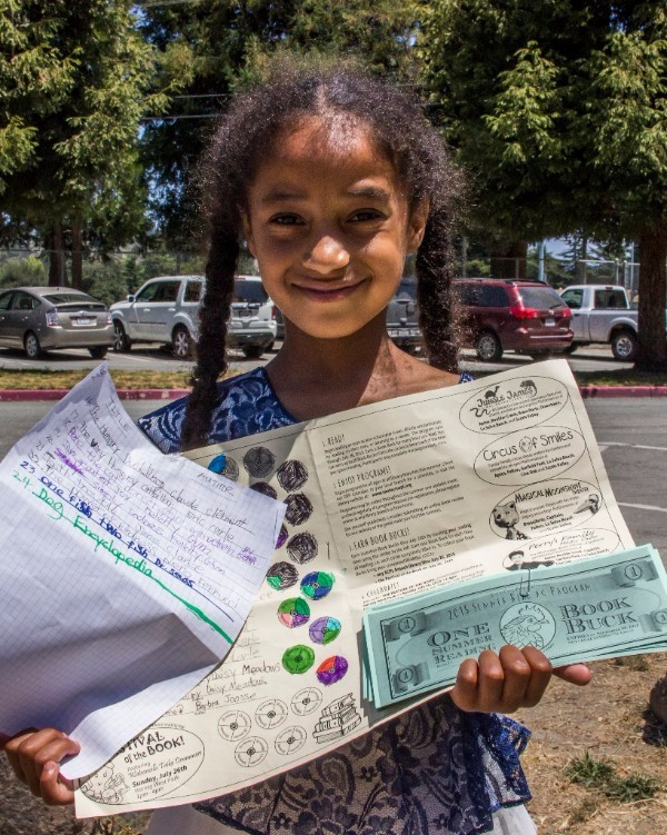 Girl summer reading sign out with book bucks