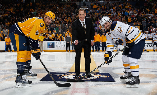 NASHVILLE, TN - NOVEMBER 28: Nashville Predators assistant coach Phil Housley drops the puck between Shea Weber #6 of the Nashville Predators and Brian Gionta #12 of the Buffalo Sabres as he is honored for his induction into the Hockey Hall of Fame during an NHL game at Bridgestone Arena on November 28, 2015 in Nashville, Tennessee. (Photo by John Russell/NHLI via Getty Images)