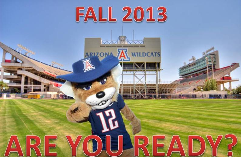 """Wilbur standing in front of Arizona Stadium saying, """"FALL 2013 ARE YOU READY?"""""""