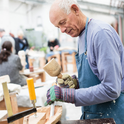 Man tijdens een workshop