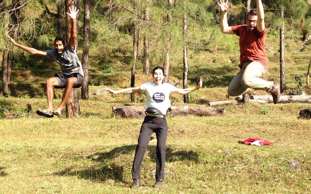 Kumaon India guided trip- Three people jumping in tea fields in India - young mountain tea