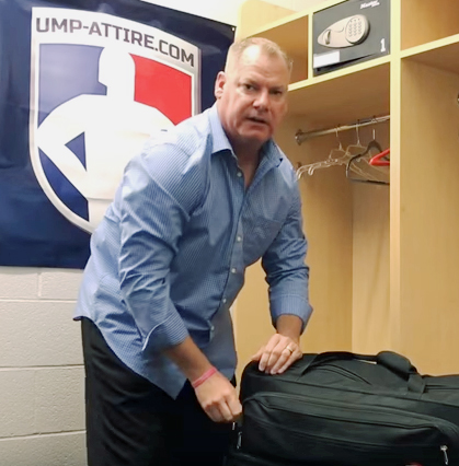 Scott Kennedy Opens His Umpire Gear Bag
