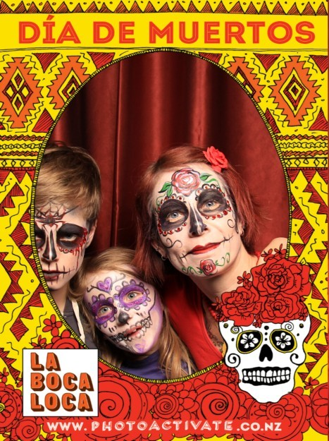 Photo of family in Day of the Dead face make-up