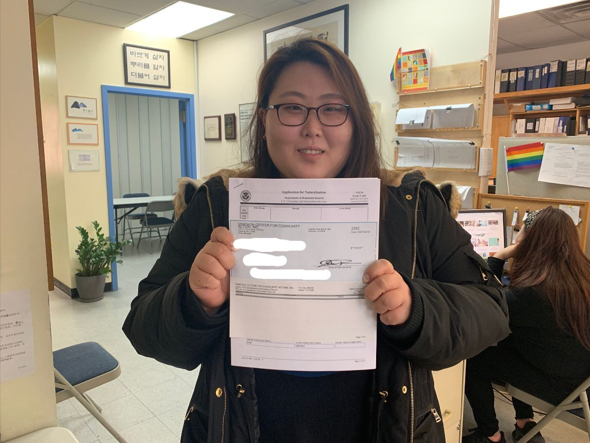 Community member wins fee voucher for her naturalization application.