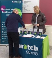 A picture of a member of the Healthwatch Surrey team talking to a gentleman at Farnham Hospital