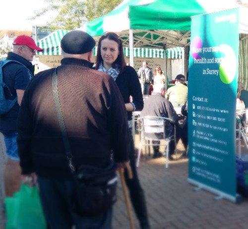 A picture of a member of the Healthwatch Surrey team talking to a gentleman on Epsom High Street