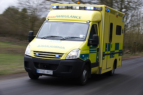 A picture of a moving ambulance
