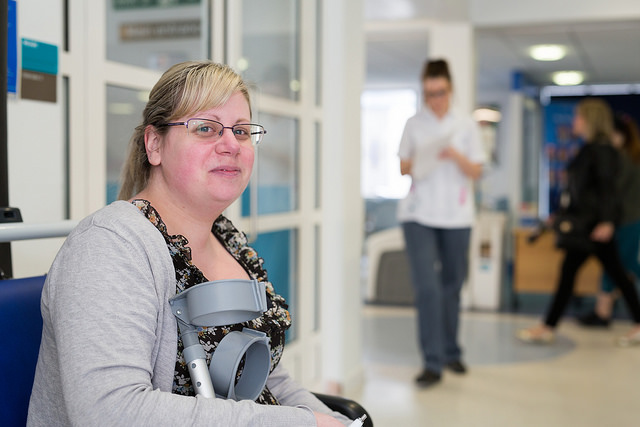 Lady with crutches waiting in hospital