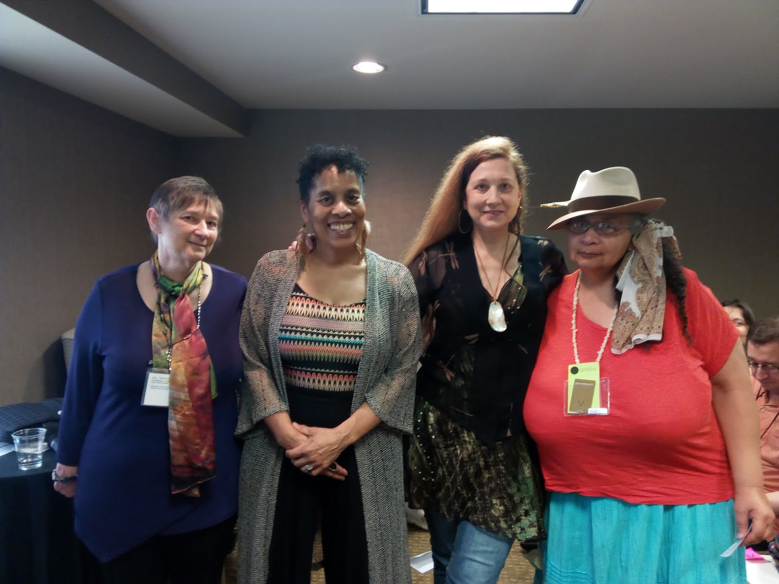 A photo of Timmi Duchamp, Andrea Hairston, Pan Morigan and Nisi Shawl after a reading.