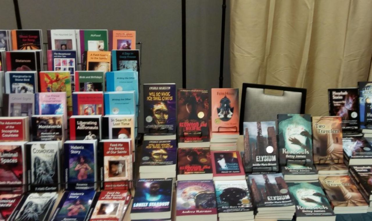 Table at the WisCon dealers' room with many of our books