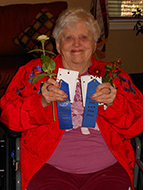 Barbara Powers holds two blue ribbons she won at the Yavapai County Fair