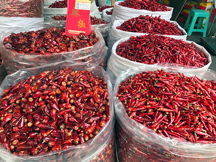 Chilies at the Chengdu wholesale spice market by The Mala Market