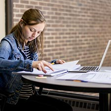 VCU School of Education student works on her laptop in Oliver Hall.