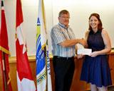 Bob Radtke, Conservation Foundation Chair, presents award to Marina Lather