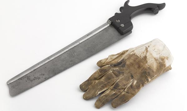 Surgeon's glove and saw