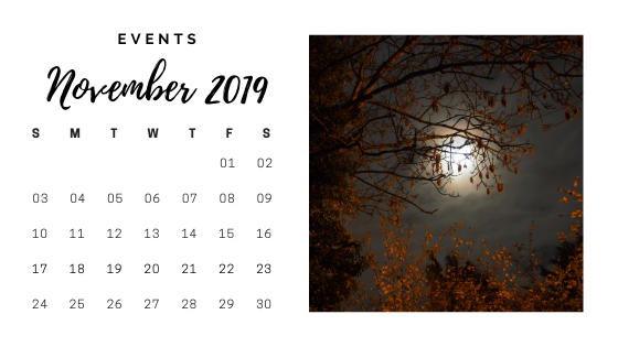 November 2019 calendar. The image to the right is of a night sky with a full moon obscured by clouds, shining through the orange-brown leaves of a tree.