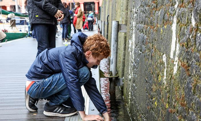 Photo of young boy playing on Albert Dock