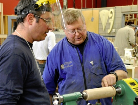 Photo of lathe instructor and student