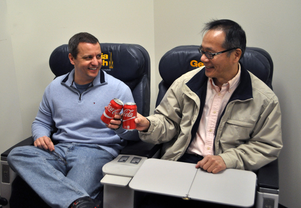 "Dr. VIgor Yang and Gary Weissel ""toast"" the new ""endowed chairs"""