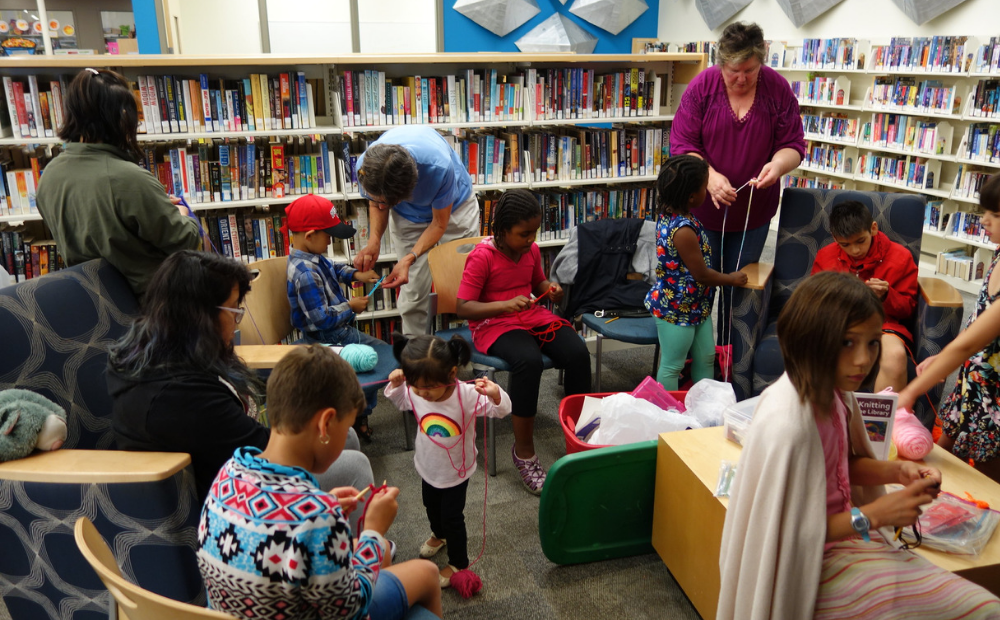 All-ages group of knitters at the library