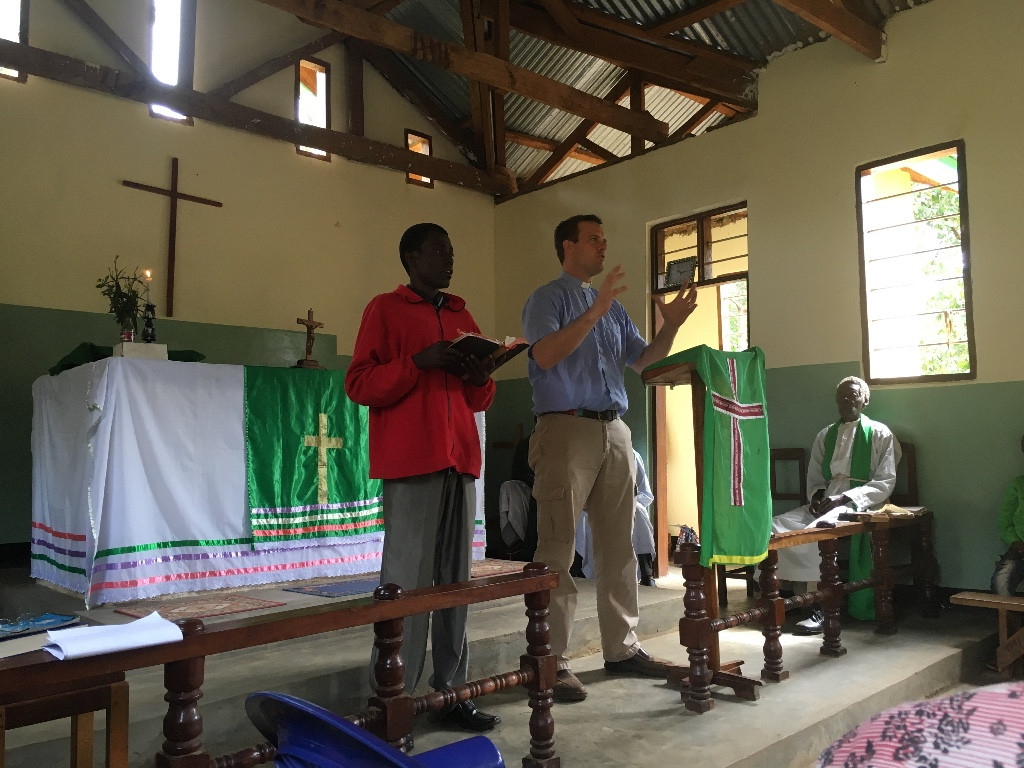Missionary Nurse Sarah Kanoy visits with a man in Tanga District, Tanzania