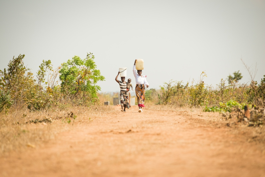 Malawi - walking from the new well (photo by Erik Lunsford)