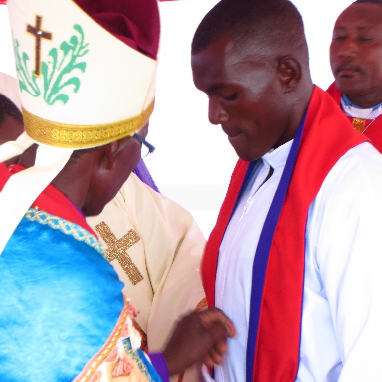 Pastor Yacobo's New Stole is Adjusted