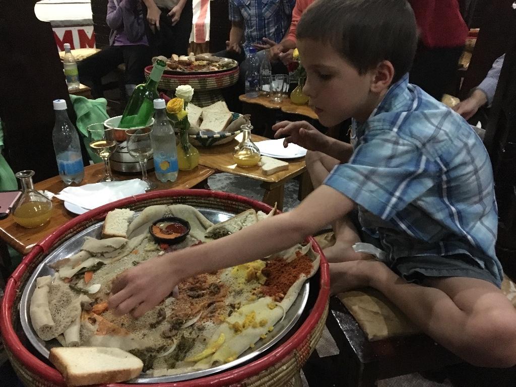 Josiah Enjoying Ethiopian Food
