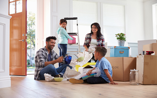 Pictured: an image of a family unpacking boxes as they move into their new home.