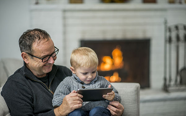 Image of Grandfather with Grandson by Fireplace