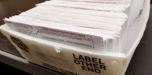 Tray of vote-by-mail ballots