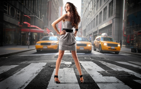 Model standing in the middle of the street
