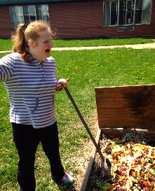 A student in McDonough-Sutter's class helps turn the compost