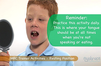 Image of child performing trainer activities with a mirror.   Scroll to top of enewsletter and click 'view in browser' to view this.