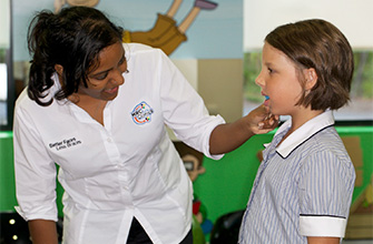 Image of child learning their trainer activities.   Scroll to top of enewsletter and click 'view in browser' to view this.