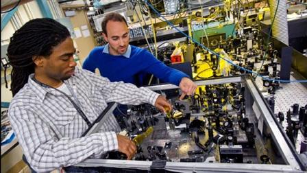 Two men working on robotics