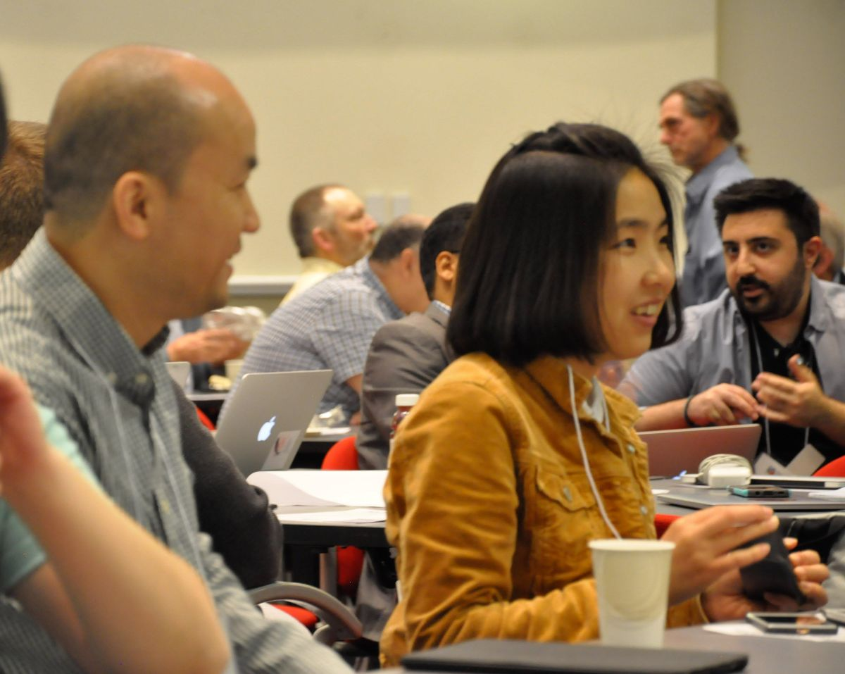 Picture of participants talking at 2019 all hands meeting
