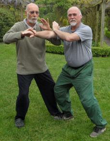 Ian Deavin pushes hands with Karel Koskuba