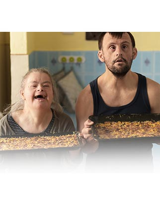 Two adults with Down syndrome cooking