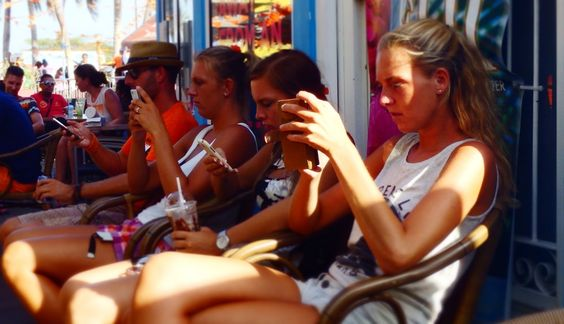 People engrossed in their mobile phones