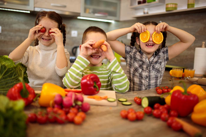 kids playing with fruits and vegetables