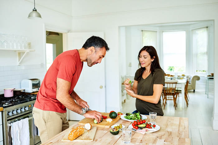 couple making meal together