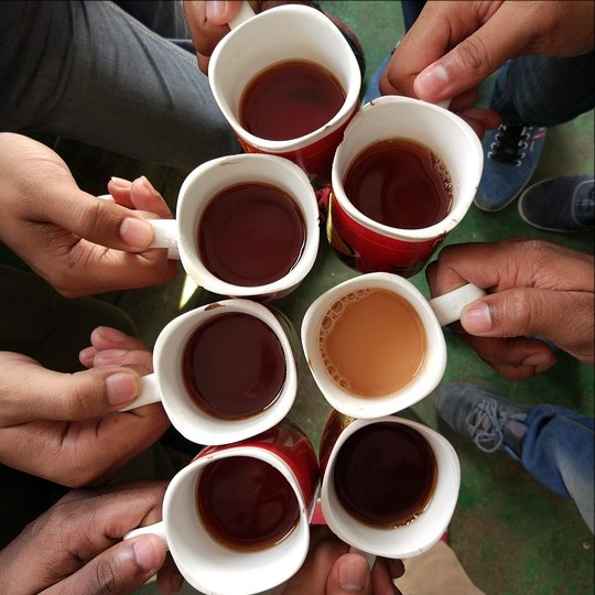 picture of coffee cups held by a number of hands