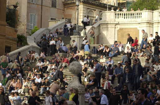 people sitting on stairs in Rome, Italy