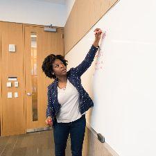 Teacher writing on a dry erase board