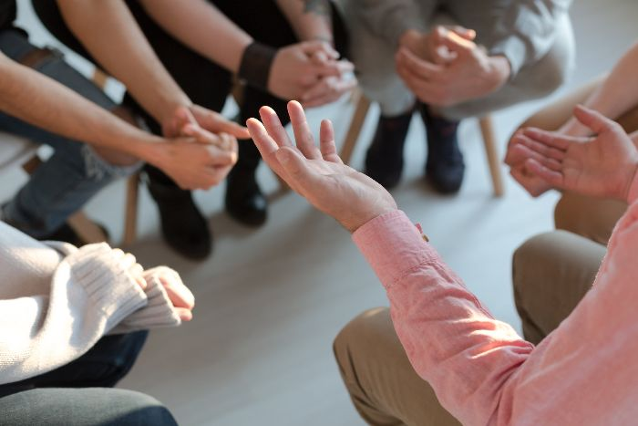 Hands of people in a support group