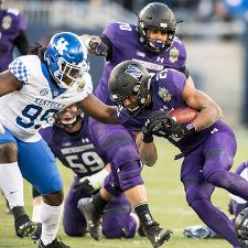 A football player getting tackled