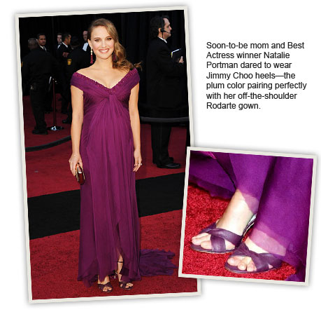 Soon-to-be mom and Best Actress winner Natalie Portman dared to wear Jimmy Choo heels--the plum color pairing perfectly with her off-the-shoulder Rodarte gown.