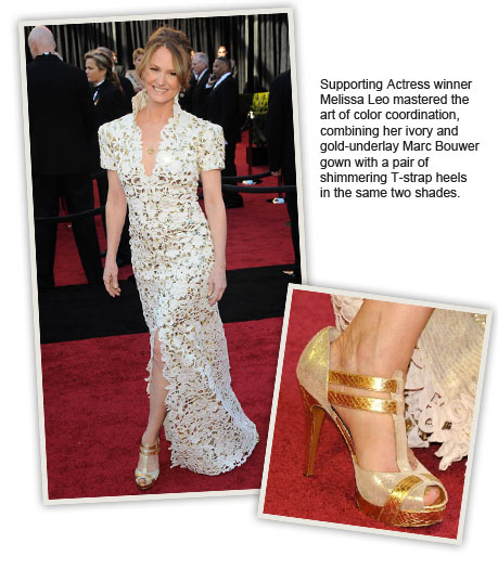 Supporting Actress winner Melissa Leo mastered the art of color coordination, combining her ivory and gold-underlay Marc Bouwer gown with a pair of shimmering T-strap heels in the same two shades.