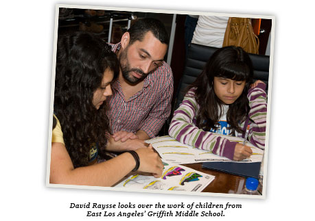 David Raysse looks over the work of children from East Los Angeles' Griffith Middle School.